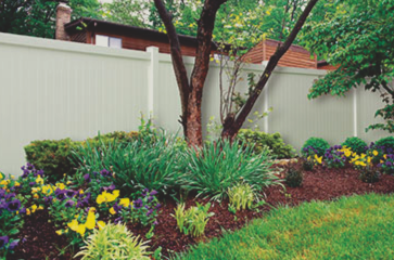 beautiful-landscaped-yard-with-almond-vinyl-fence-providing-privacy-and-security-to-backyard
